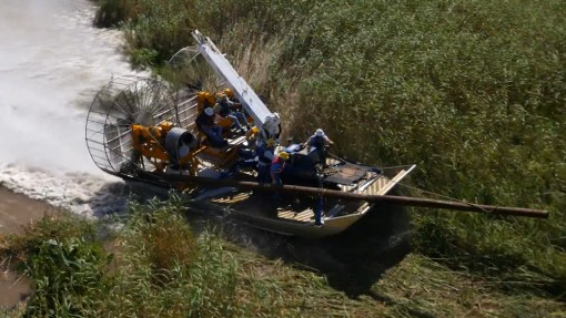 MTT Turbine Powered Airboats for Sensitive Wetland Work – MTT Turbine Airboat Exiting Water and Driving on Dry Land - https://www.marineturbine.com/turbine-powered-workboats/